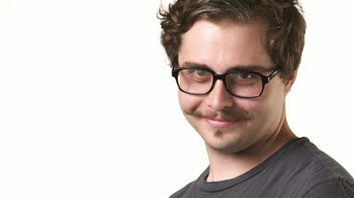 stock-footage-white-male-hipster-with-a-mustache-and-glasses-looks-into-the-camera-and-smiles-on-a-white